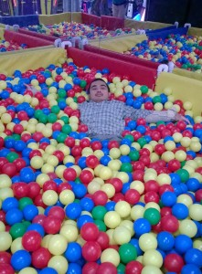 Edrick enjoys the BRS Ball Pit.